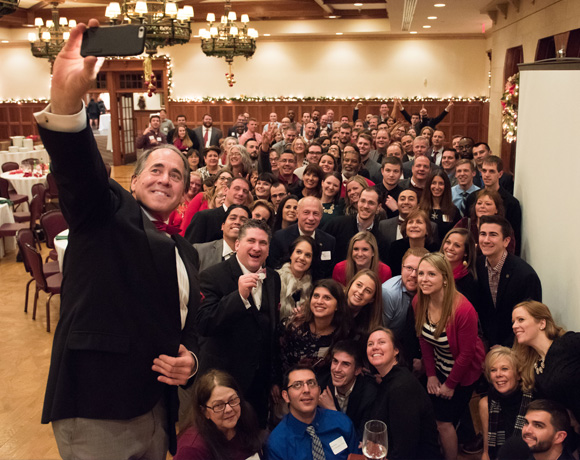 PrimePay - Group photo of CEO William Pellicano and employees of West Chester main office at holiday party.