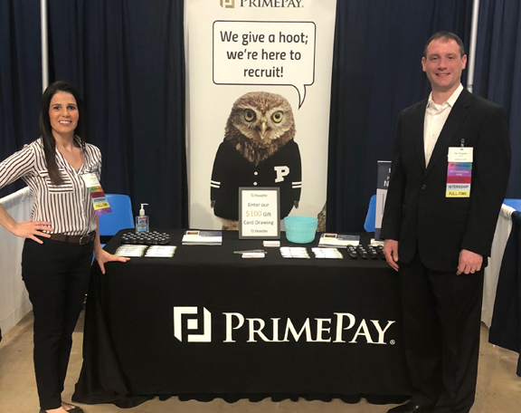 PrimePay - Photo of two PrimePay team members attending a local career fair.